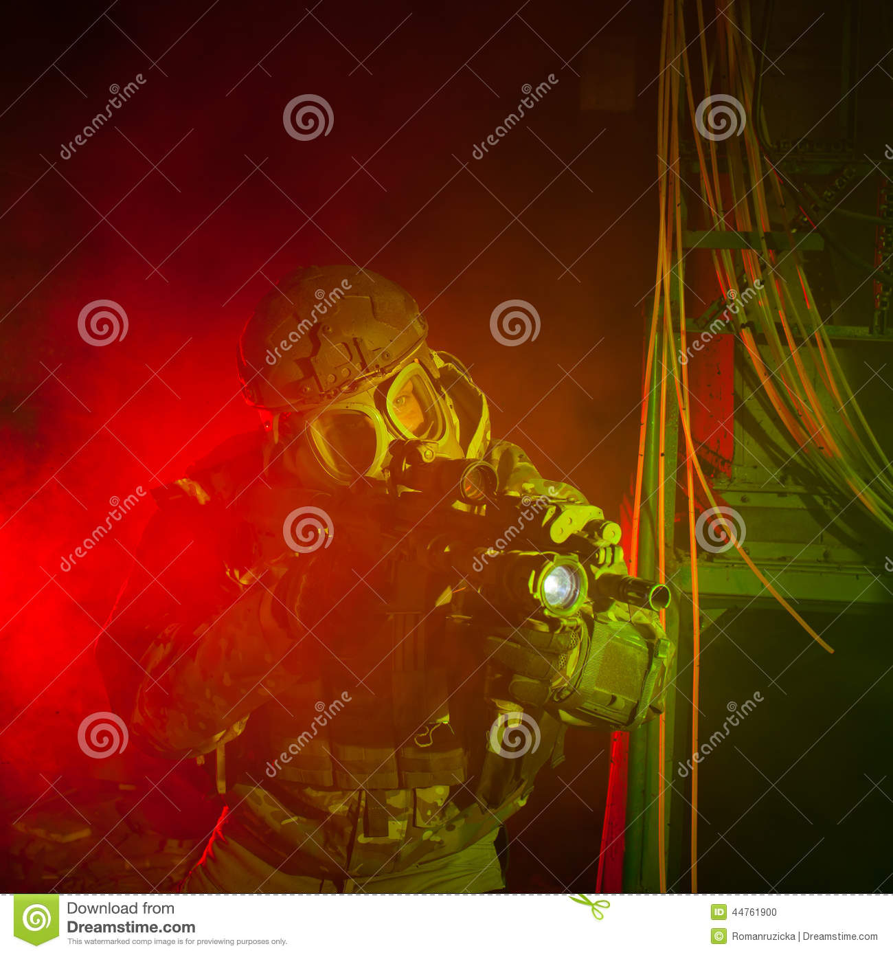 Special forces soldier with gas mask during night mission