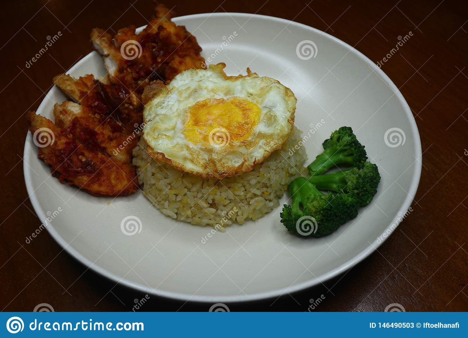 Special fried rice with spicy chili fried chicken sauce, broccoli and fried omelet