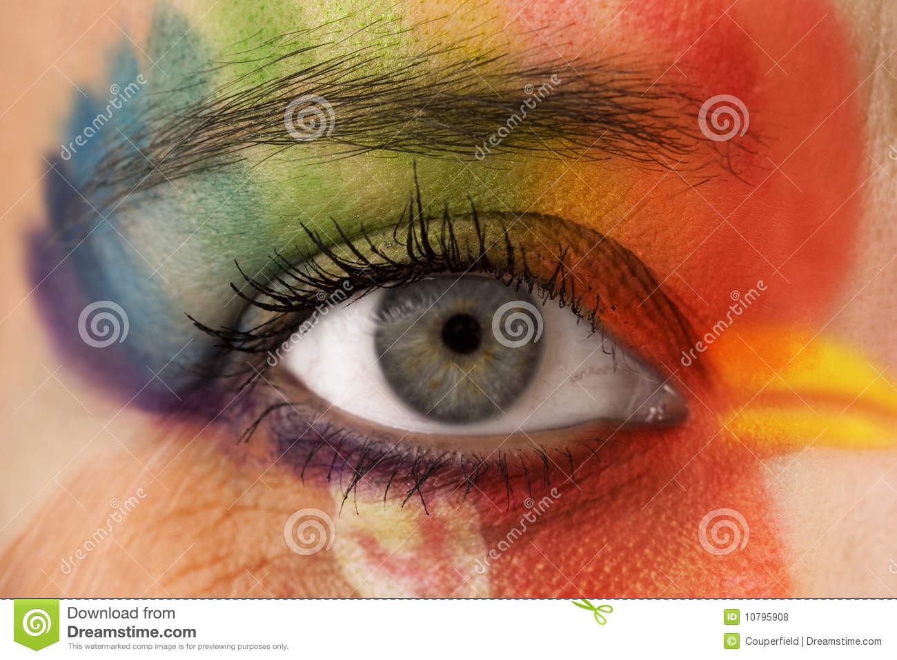 Eye make up - rainbow color painting in the shape of head.