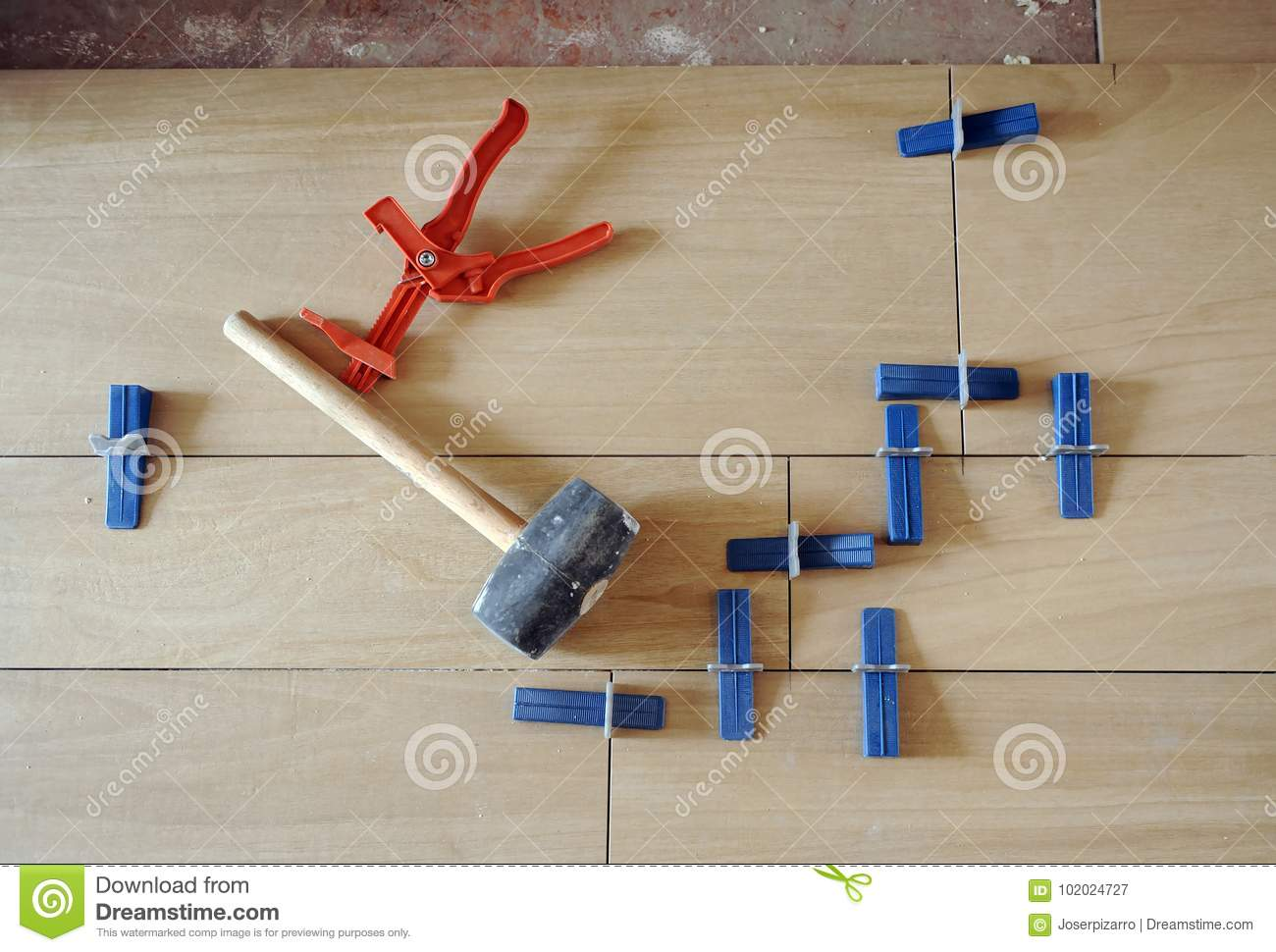 special tools and rubber hammer to place a porcelain stoneware floor