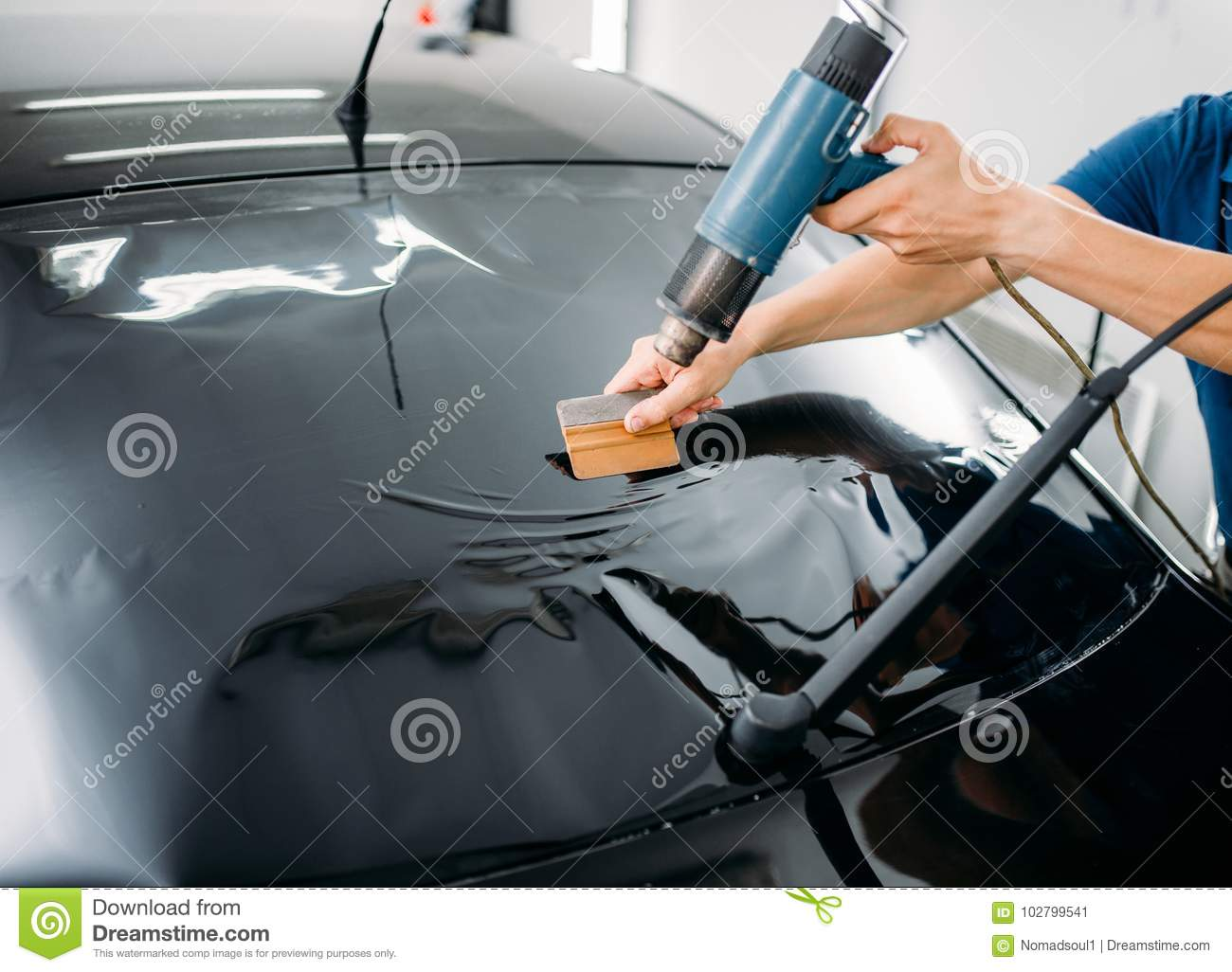 Specialist With Drier Tinting Film Installation Stock Image
