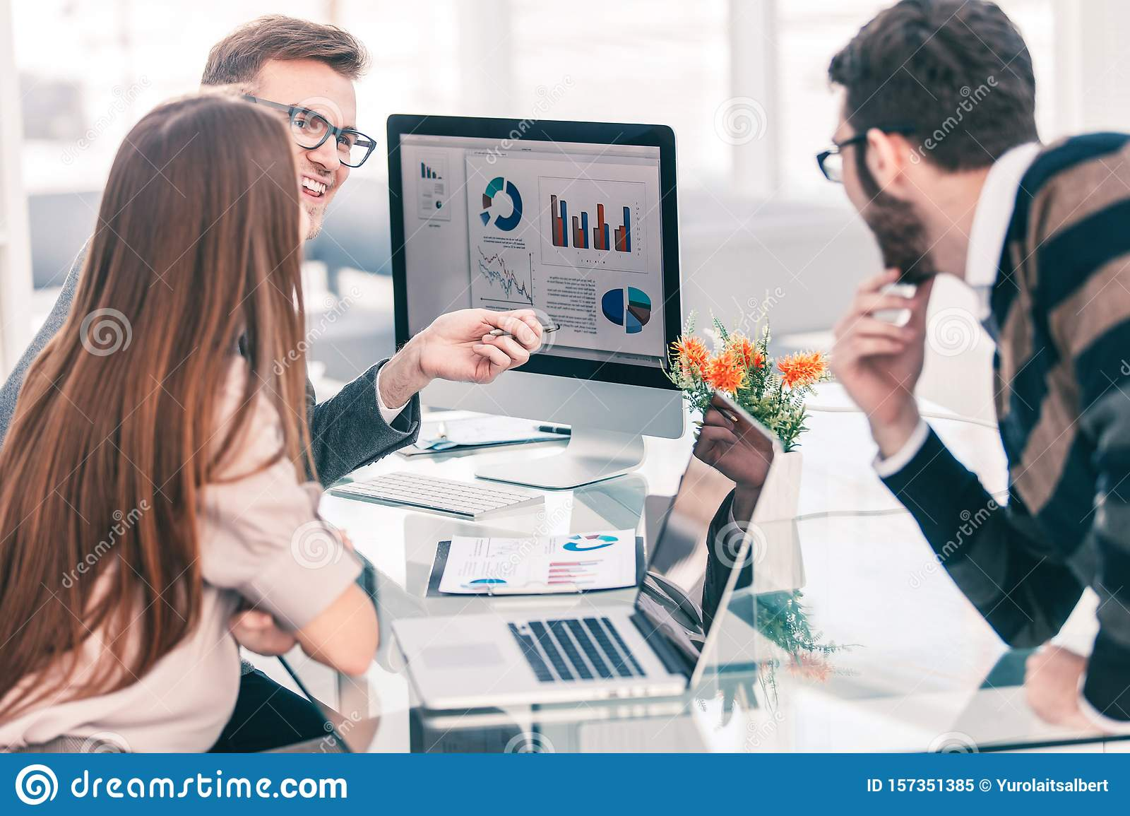 specialist in Finance and business team doing analysis of marketing reports,