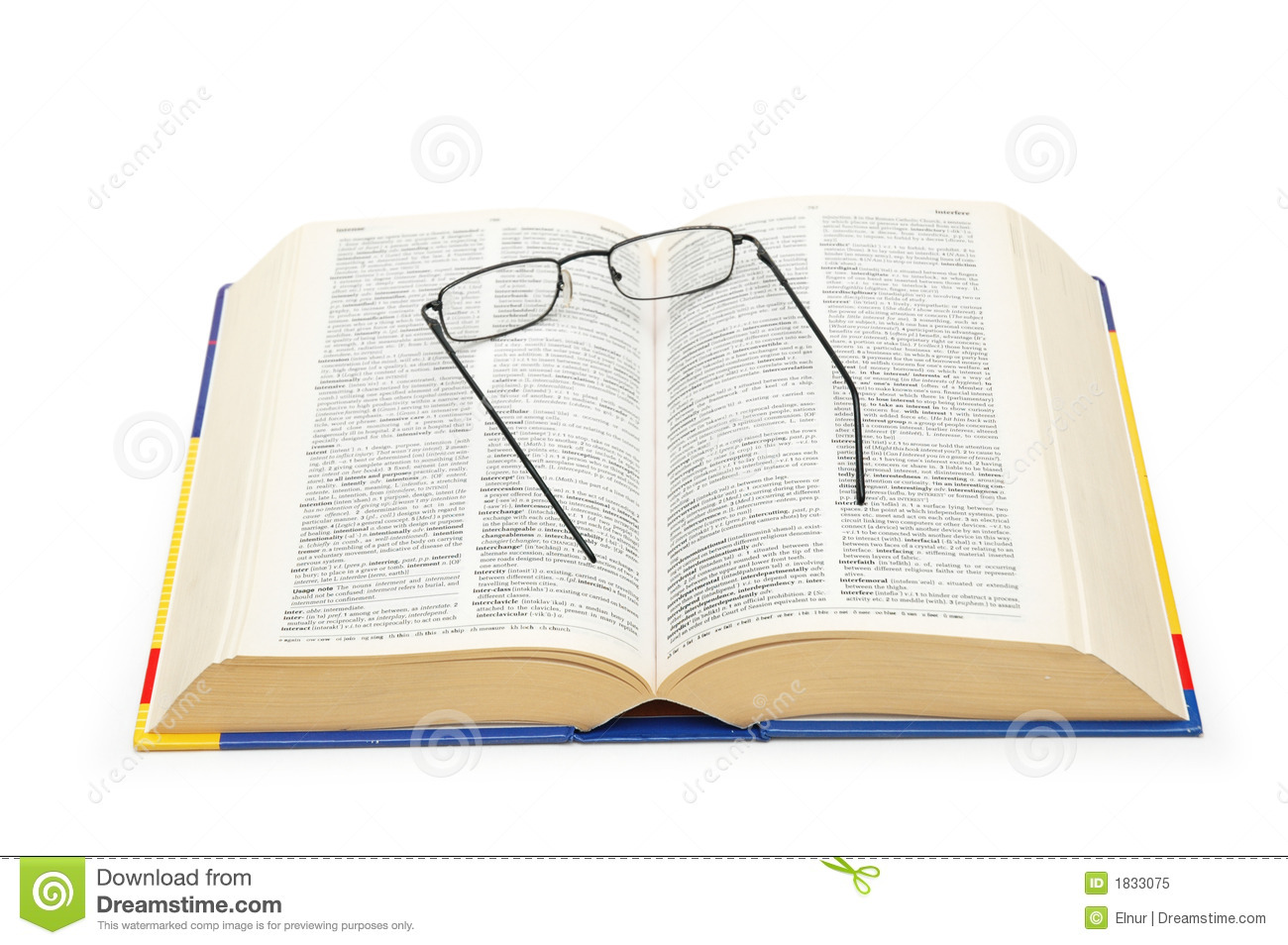 Spectacles over the open dictionary royalty free stock for Open dictionary