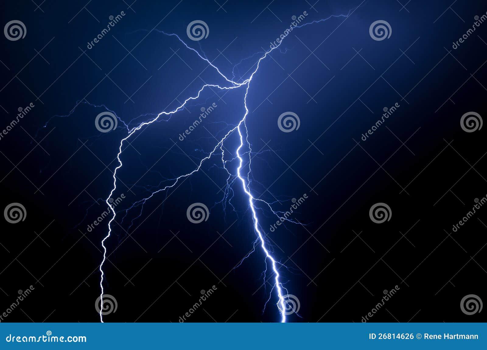 Spectacular blue lightning strike at night