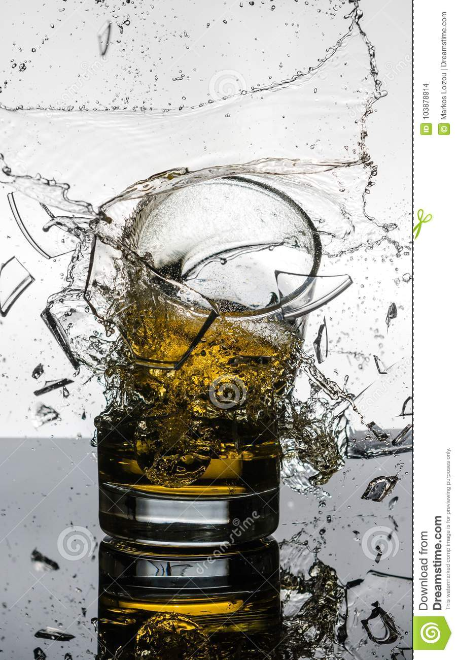 Spectacular High Speed shot of whiskey Glasees breaking