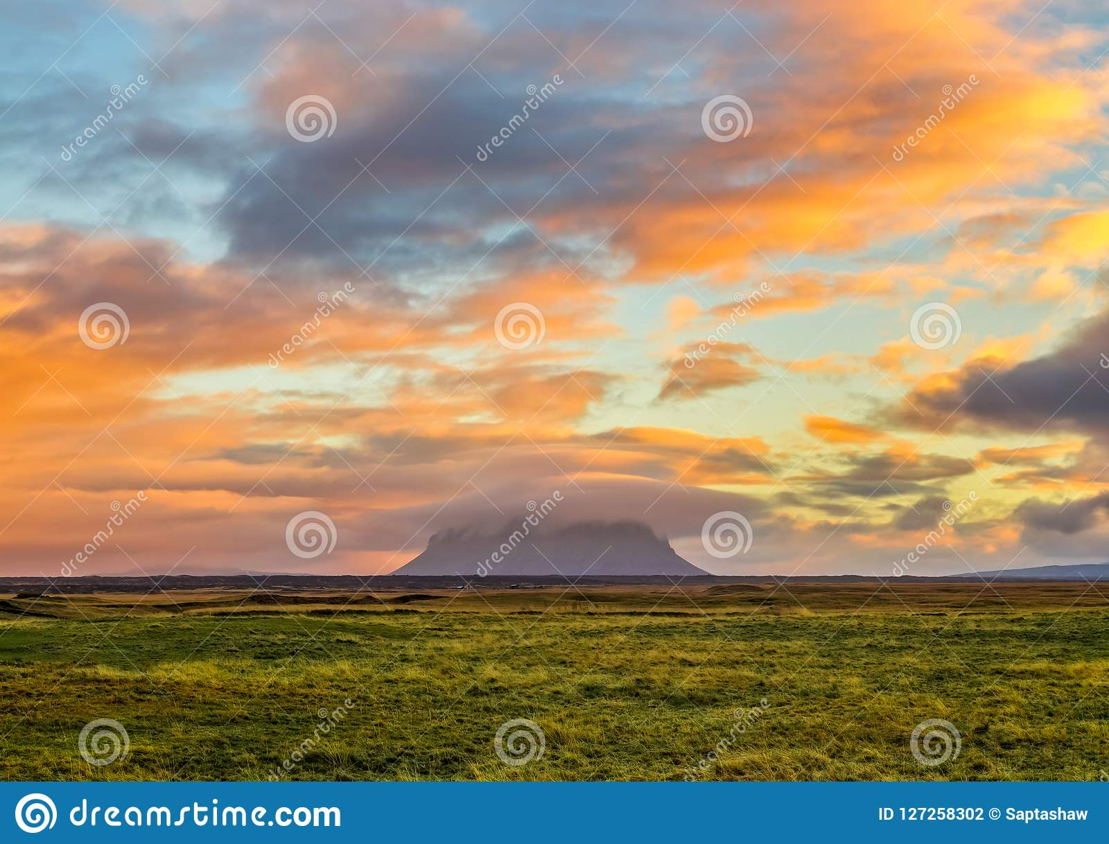 A Spectacular sunrise in Iceland with Mount Hekla covered in ora