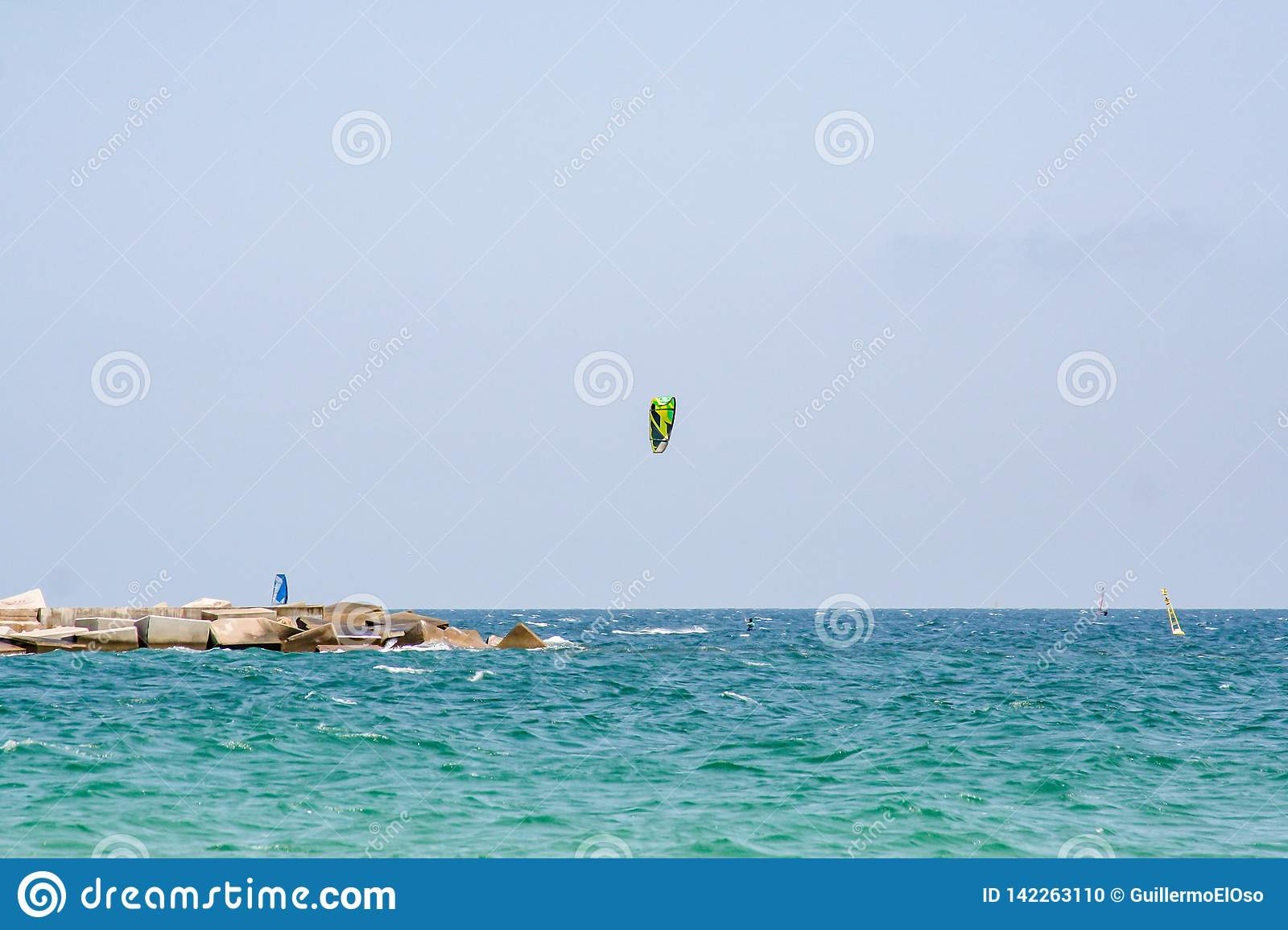 Spectacular view over the sea with kite surfer