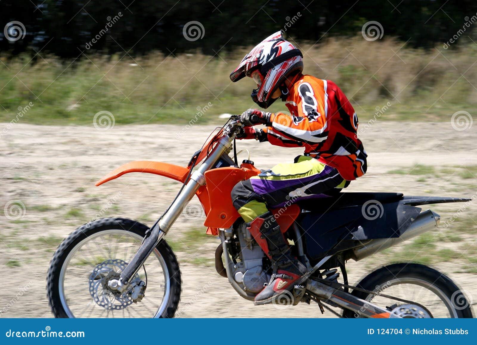 Speeding Moto X Bike Rider With Blurred Background As He