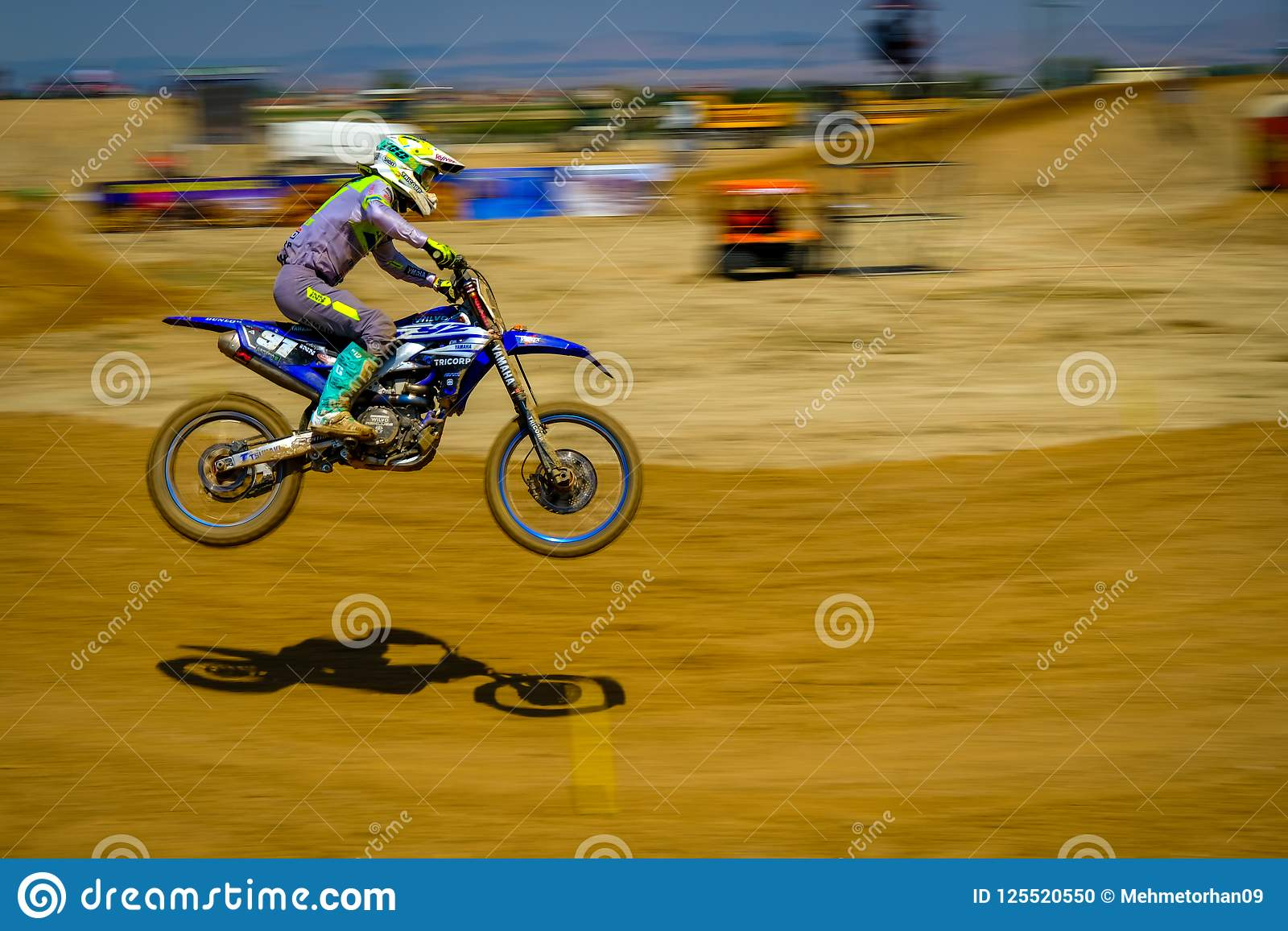 Speedy Dirt Bike At Motocross Race Driving Fast