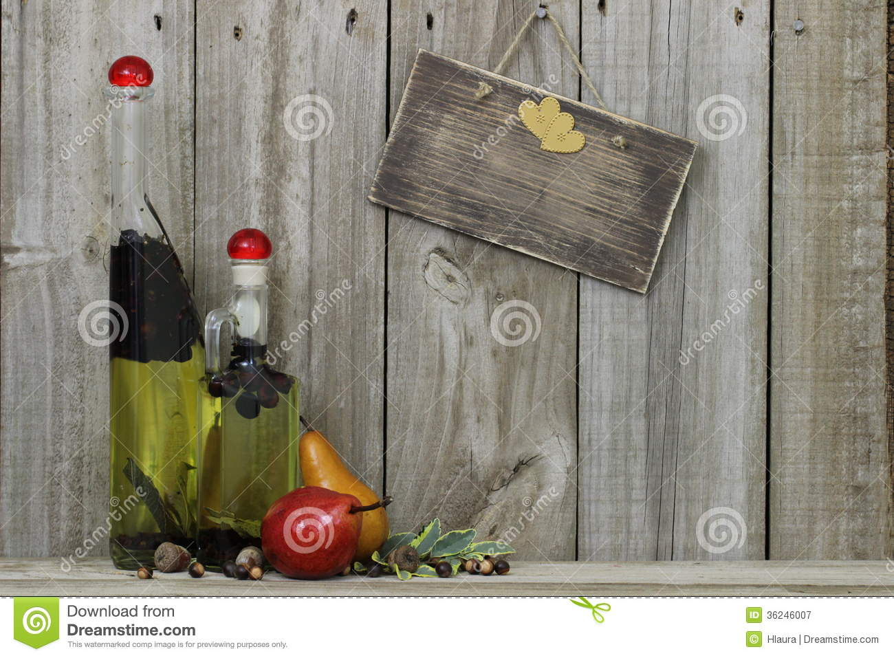 Spice oil jars with pears and blank wood sign
