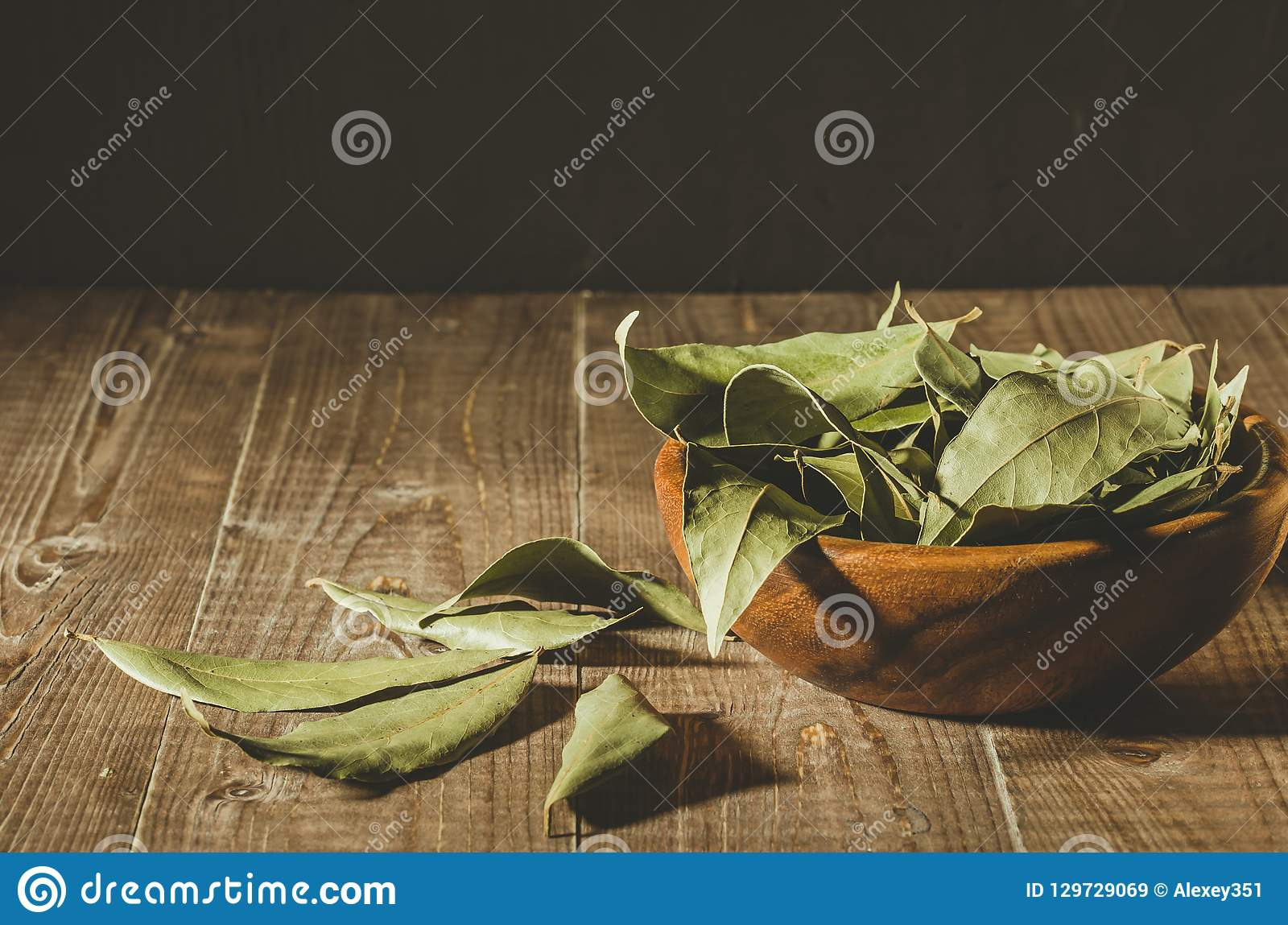 Spices of bay leaf in rural style/bay leaf in a wooden bowl on a