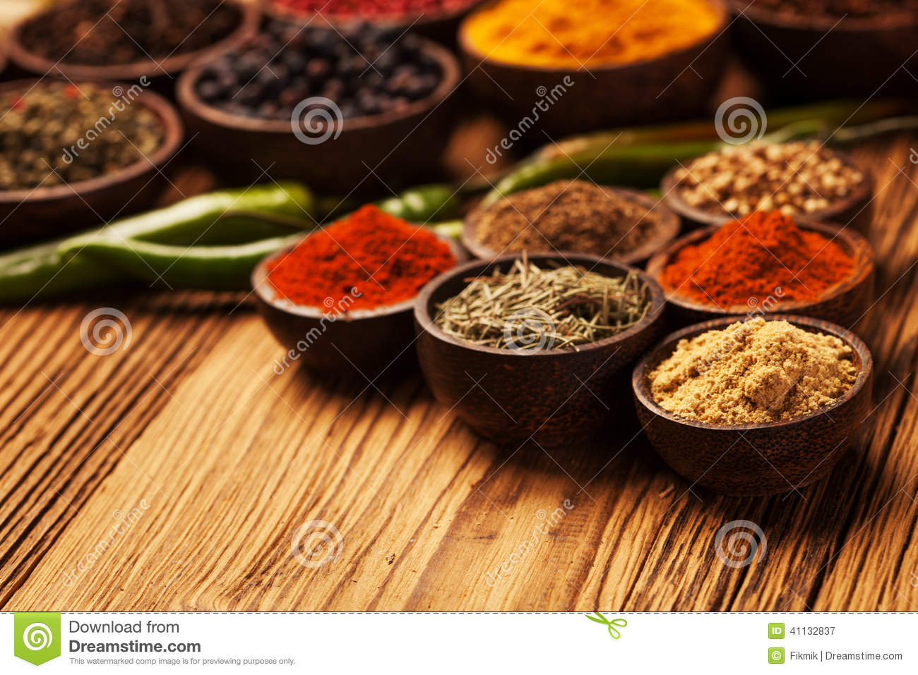 Spices and herbs in wooden bowls stock photo image for Cuisine wooden
