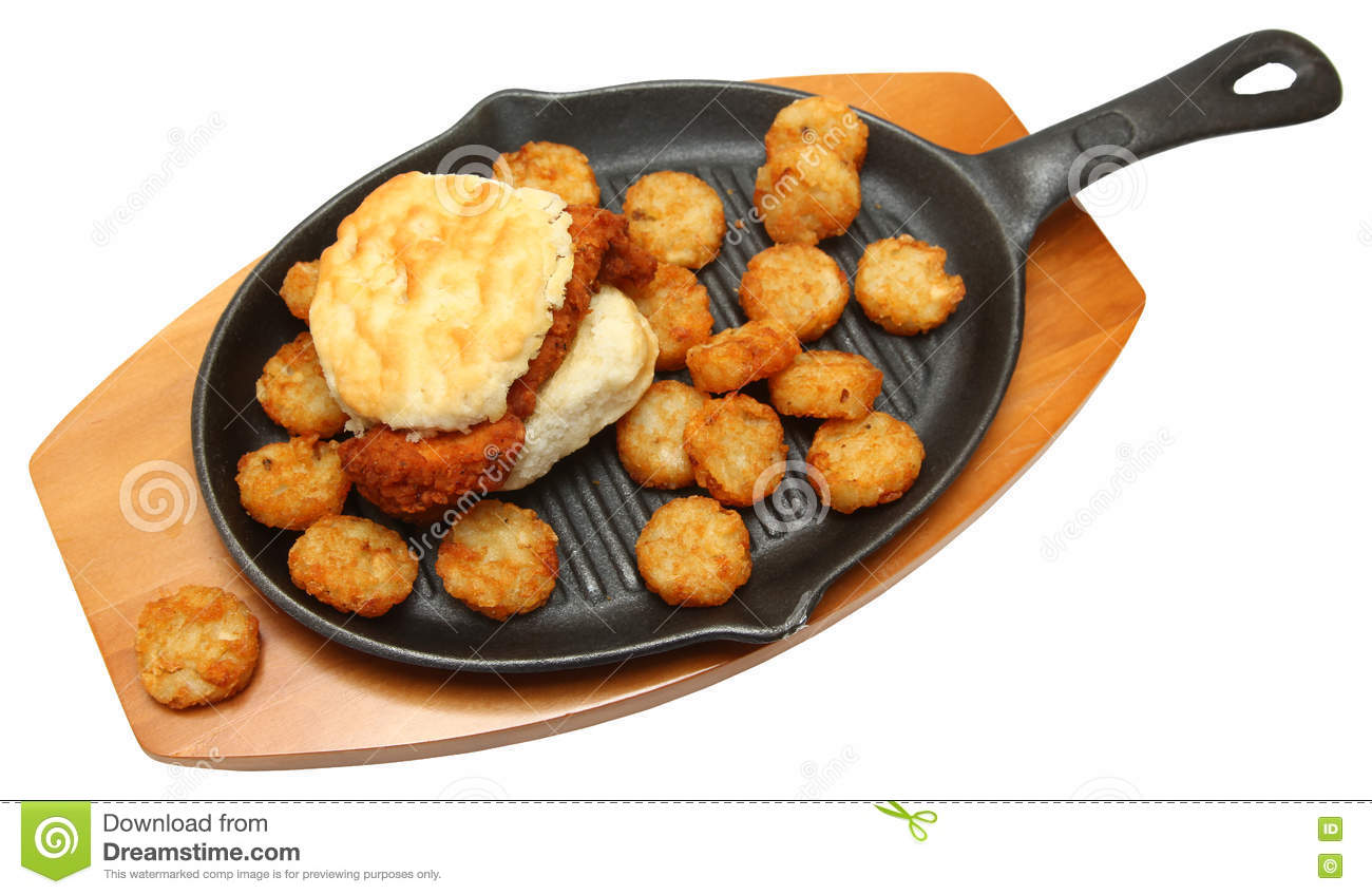 Fried Chicken Biscuit And Hashbrowns On Skillet Stock ...