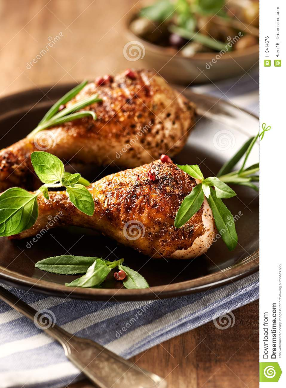 Spicy Chicken Legs with Herbs. Roasted chicken drumsticks, crispy golden brown skin.