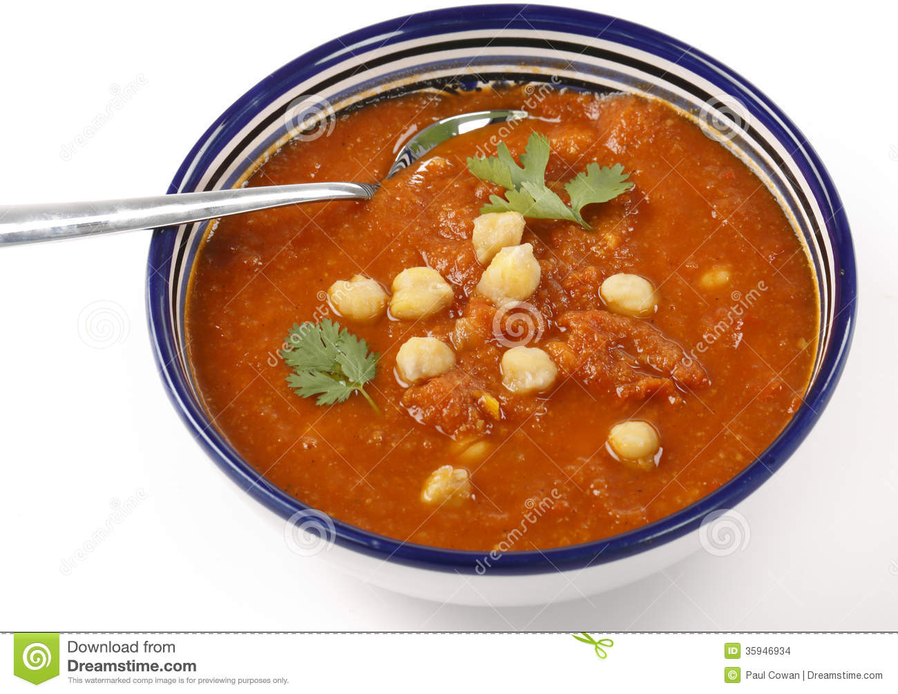 Spicy tomato and chickpea soup in a traditional Tunisian bowl with a ...