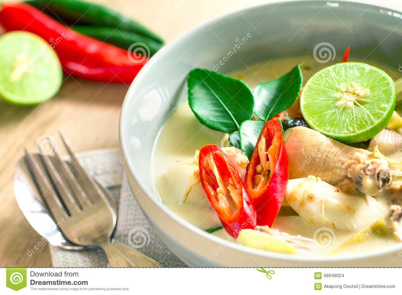 Spicy creamy coconut soup with chicken , Thai food called Tom Kha Gai on the wooden table
