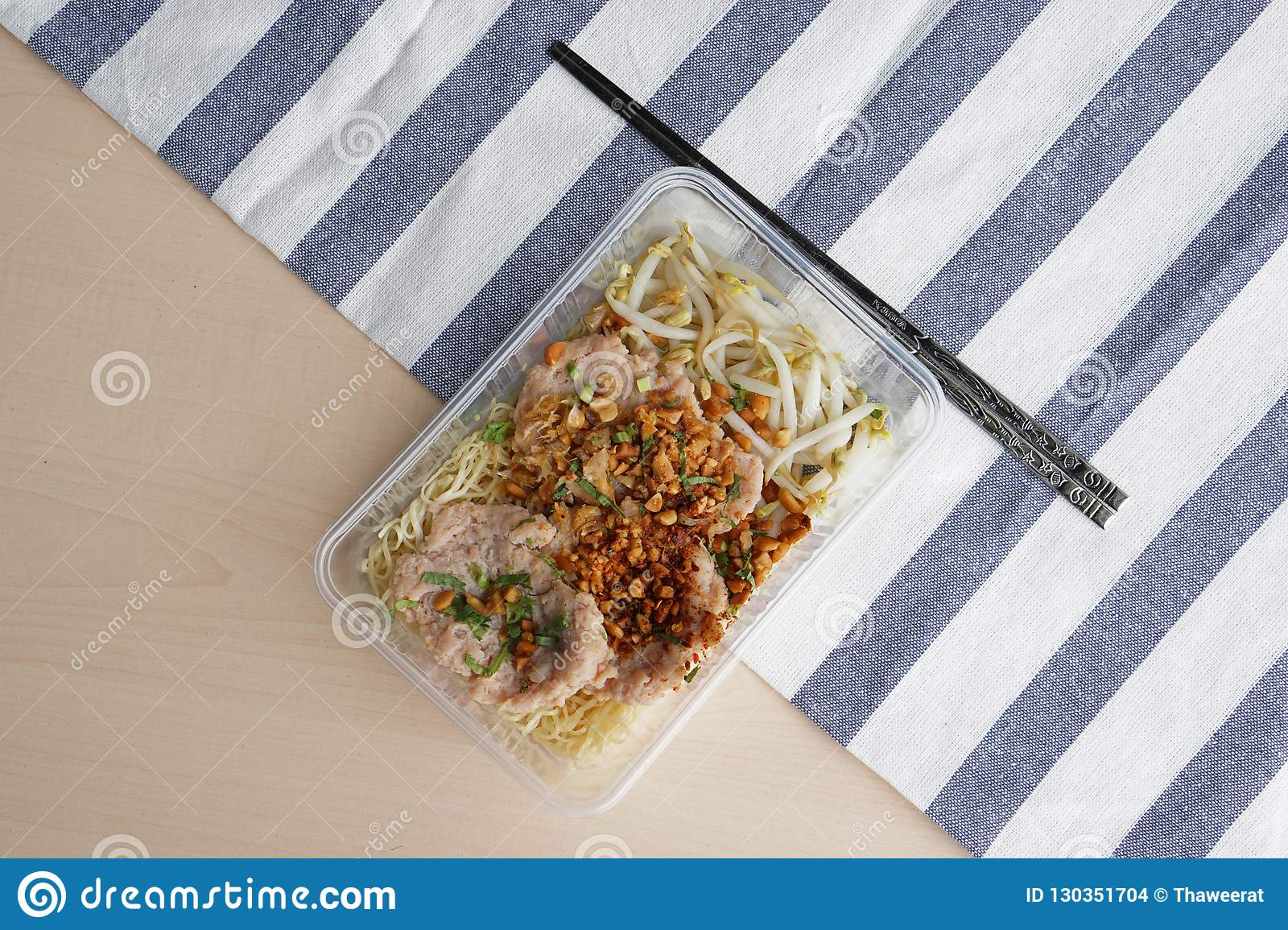 Spicy Egg Noodle With Marinated Pork Chop On Wooden
