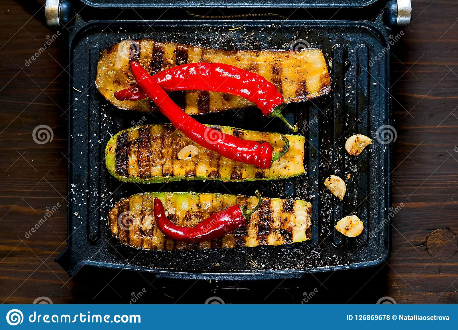 Spicy hot grilled zucchini and eggplant, cooked on an electric grill. Banner. The concept of healthy eating and delicious food.