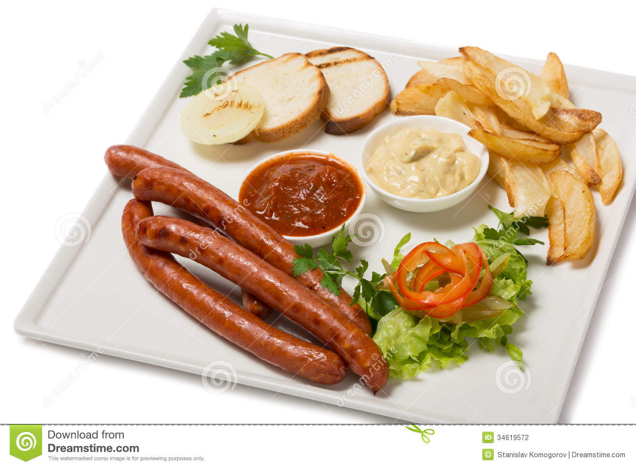 Spicy smoked sausage with cheese and fry potatoes in a pan, and salad.