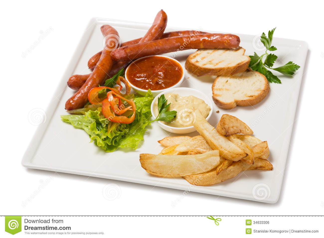 Spicy smoked sausage with cheese and fry potatoes in a pan and salad.