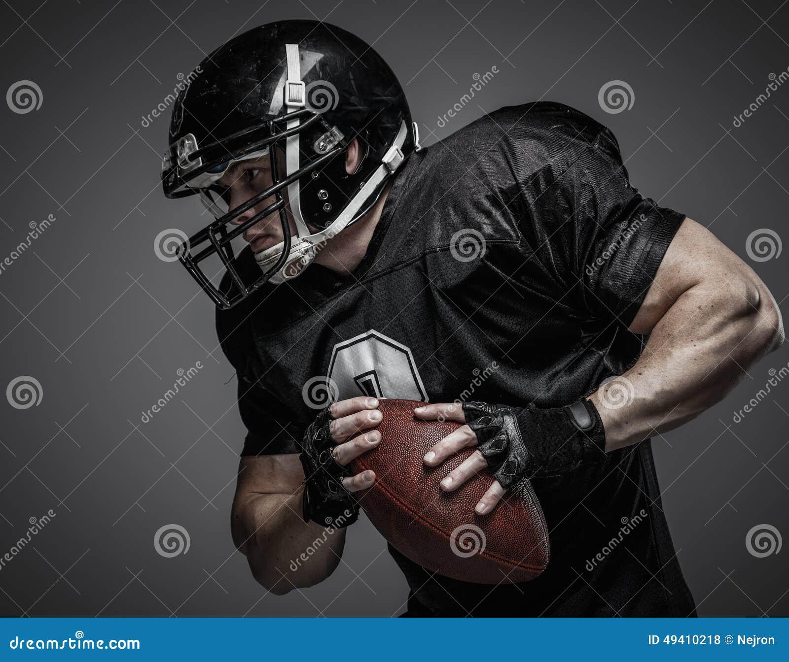 Download Spieler Des Amerikanischen Fußballs Stockfoto - Bild von schwarzes, erwachsener: 49410218