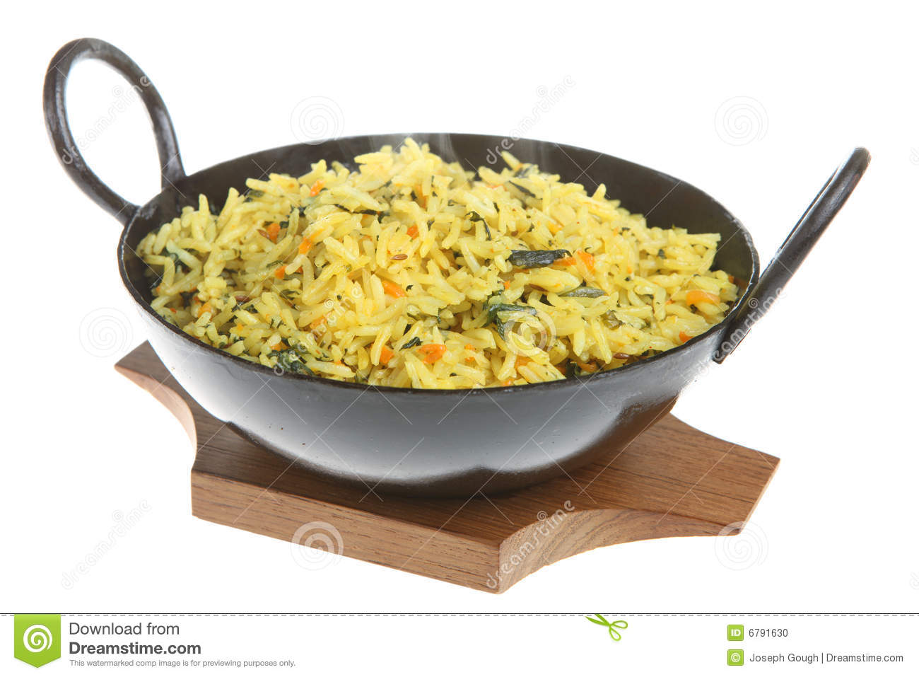 Indian spiced rice with spinach and carrot (with visible steam rising ...