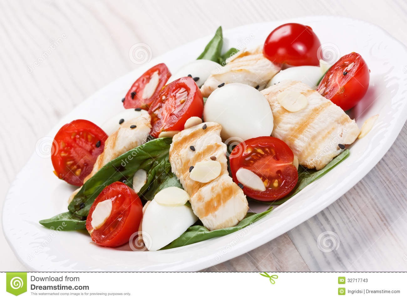 Spinach, grilled chicken, cherry tomatoes, and quail eggs salad with ...