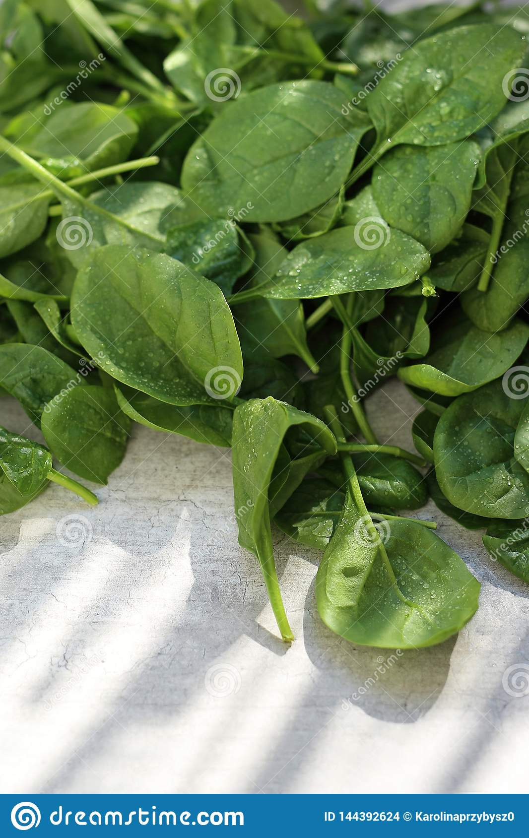 Spinach, fresh green leaves on the kitchen counter.