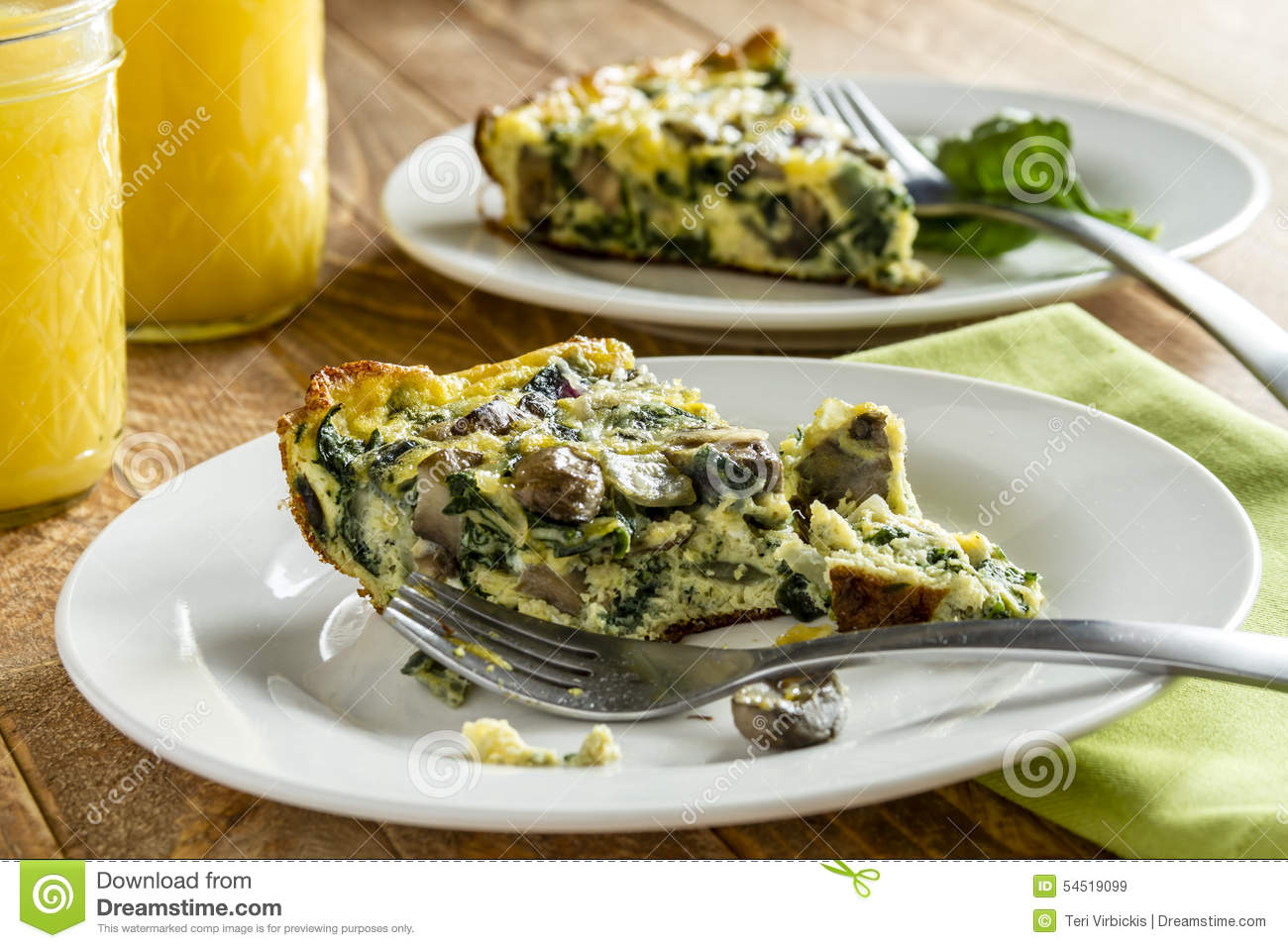 slices of spinach mushroom and egg frittata sitting on white plates ...