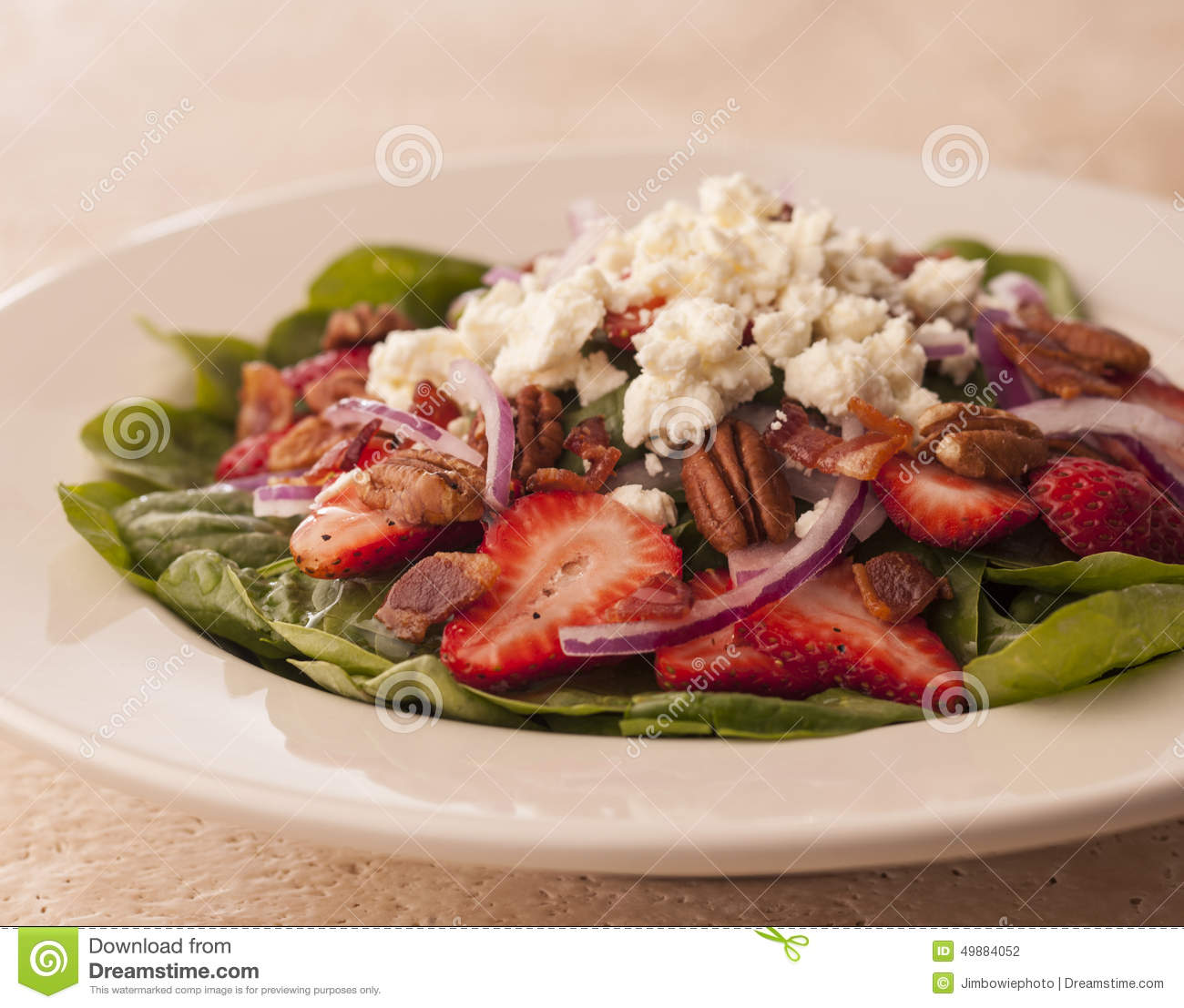 Spinach Salad With Strawberries And Goat Cheese Stock Photo - Image ...