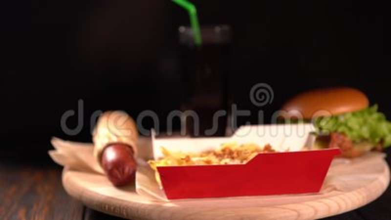 Spinning Grilled Hot Dog Burger Chips And Soda Stock Footage