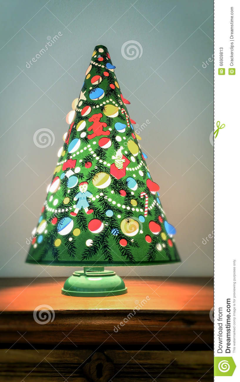 a spinning vintage christmas tree lamp vertical stock image