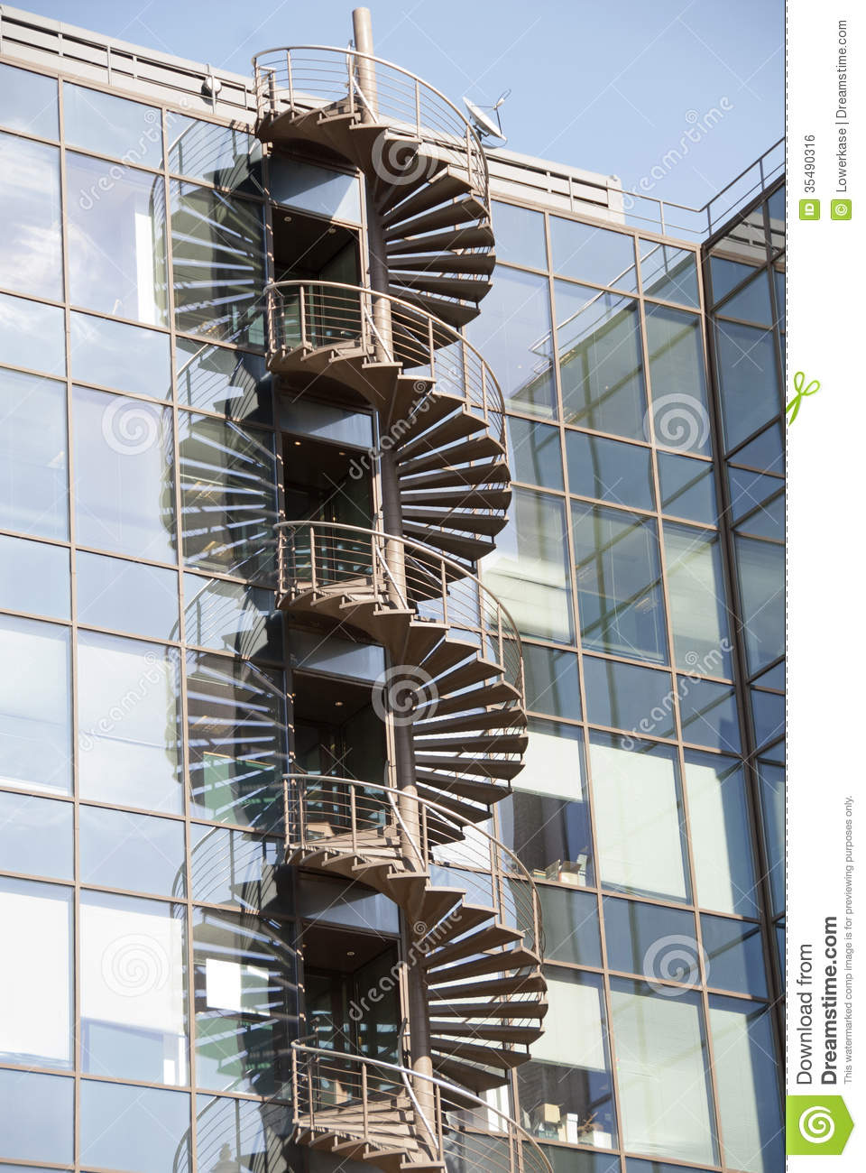 Awesome Spiral Fire Escape Staircase On External Wall Of Office Block