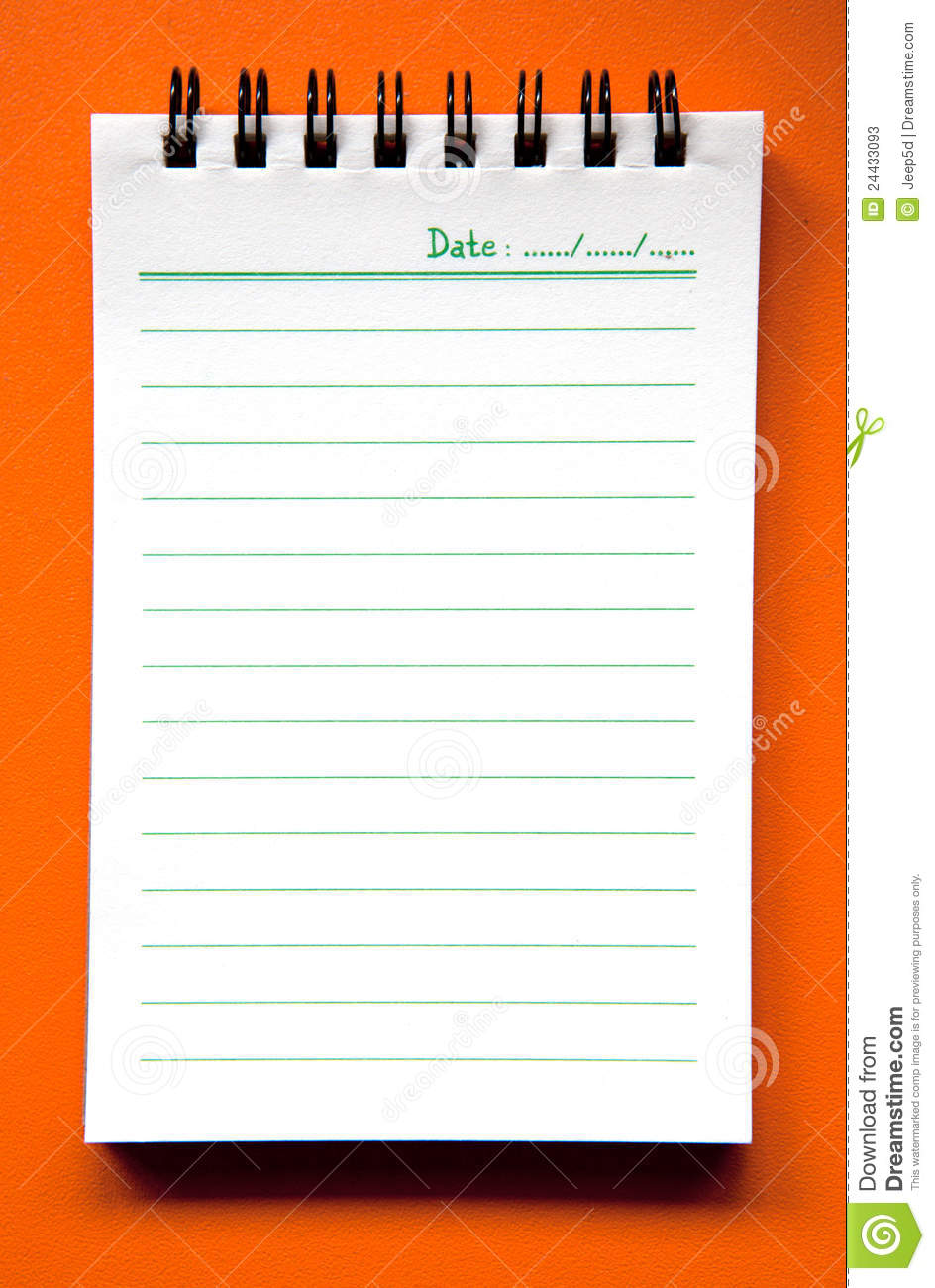 spiral notebook on orange background stock photos image