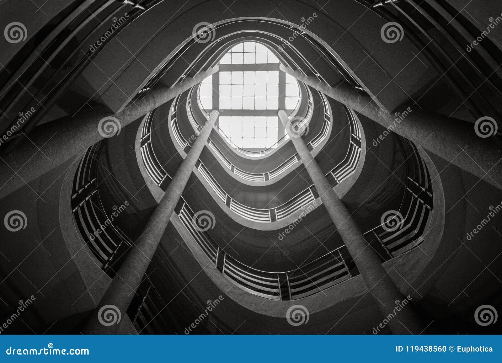 Spiral staircase climbing upward, black and white