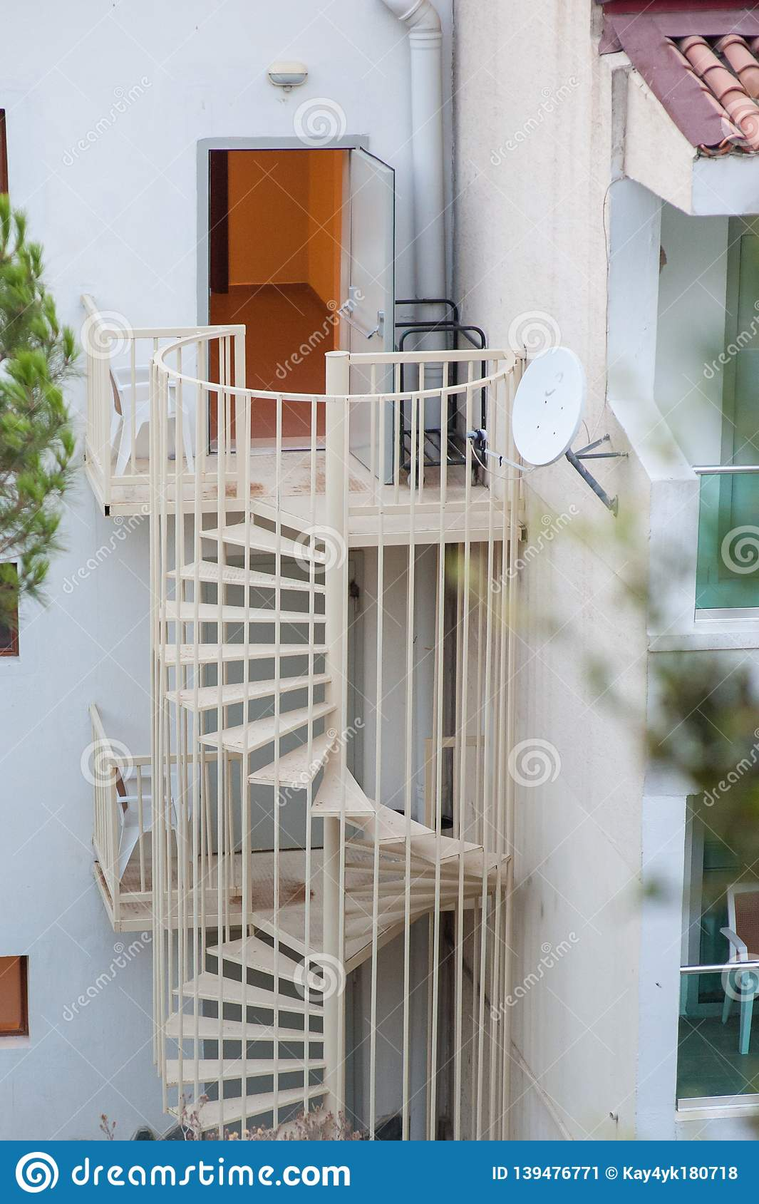 Spiral staircase in the street right outside the door
