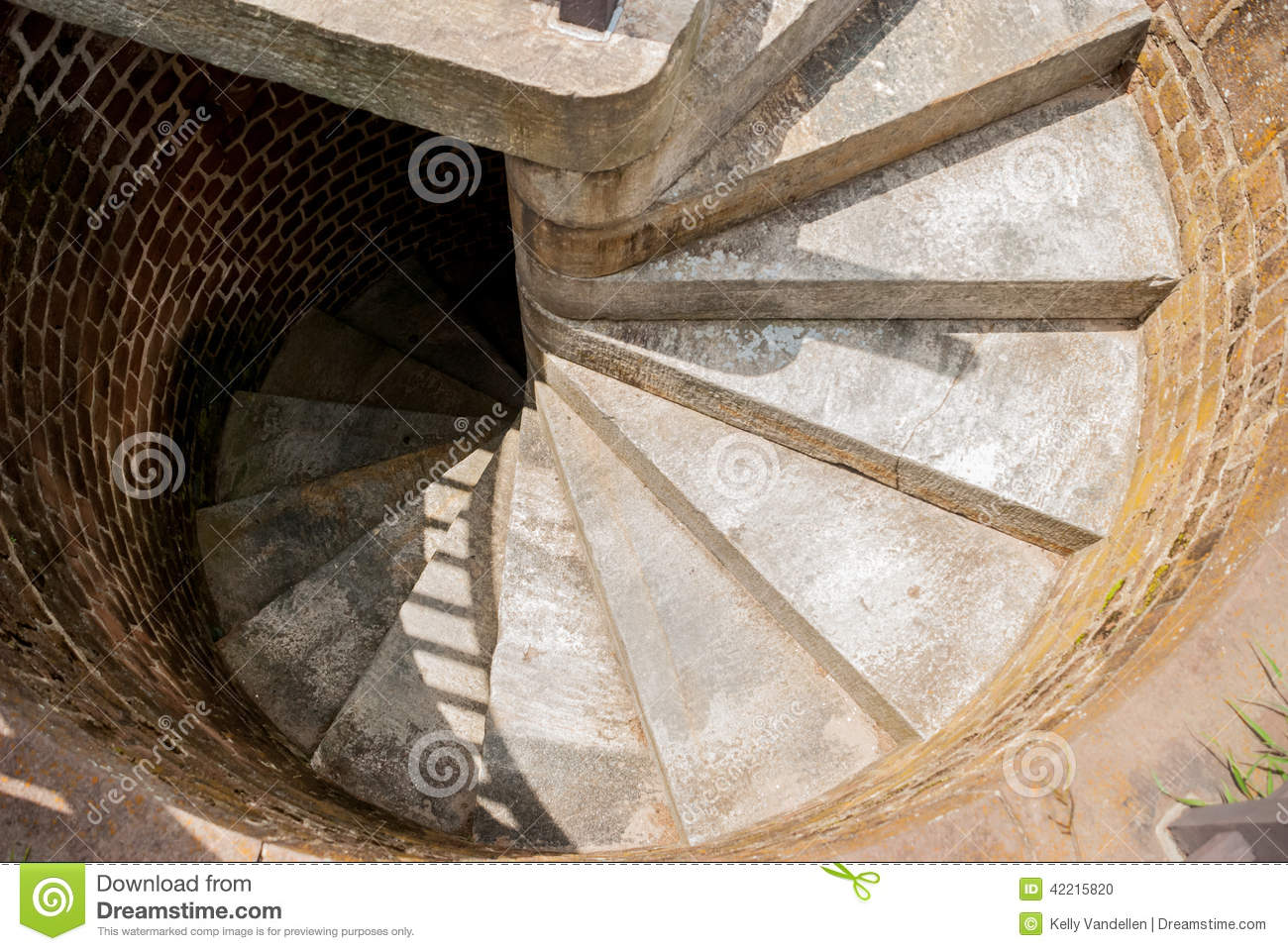 Tight Concrete Steps Work Up A Spiral Staircase To The Top Of A Lighthouse