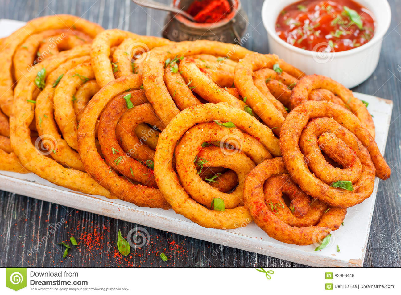Spirals of the potato and cheese in oil.