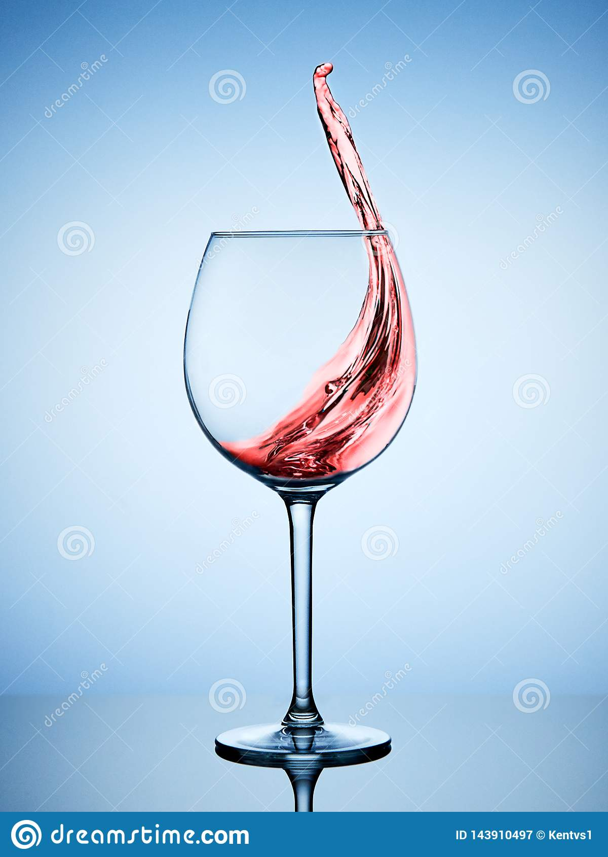 A splash of red wine in a glass