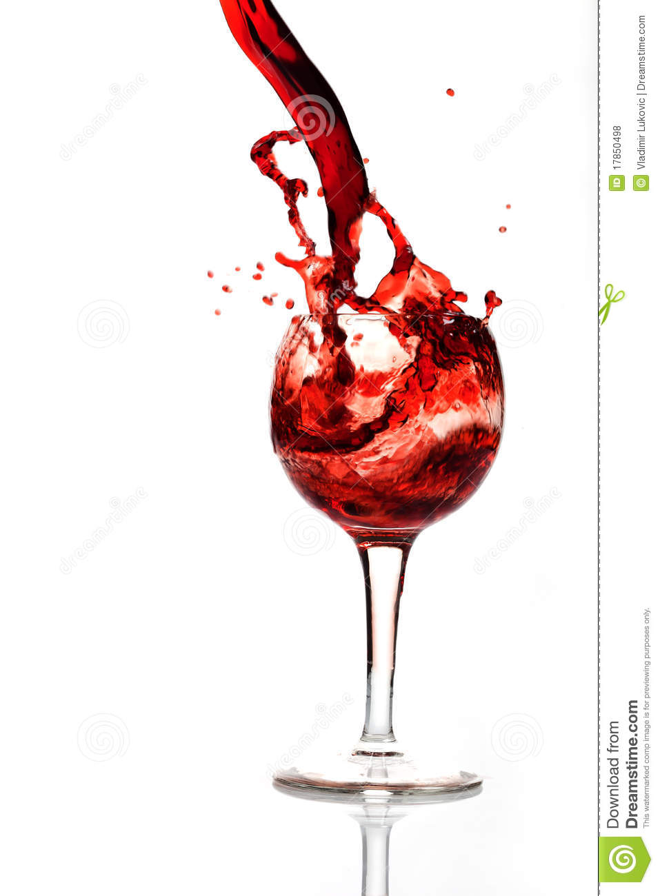 A splash of wine in glass stock photo. Image of macro ...