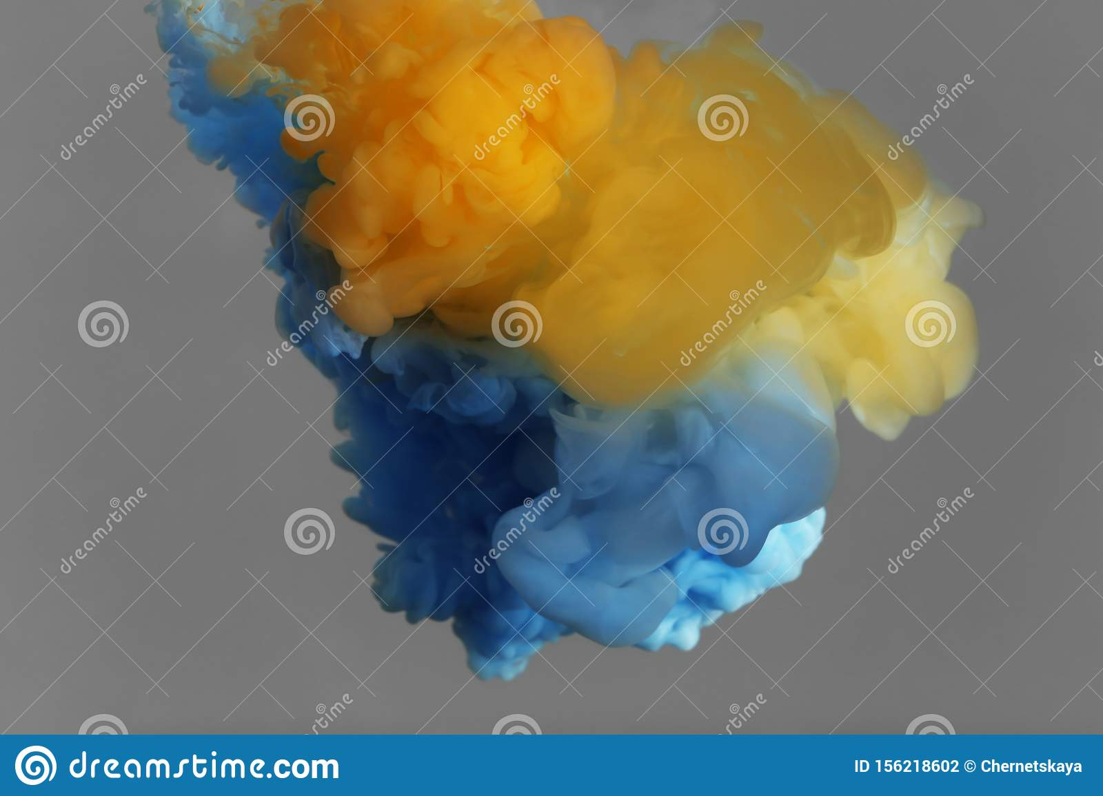 Splash of yellow and light blue on grey background