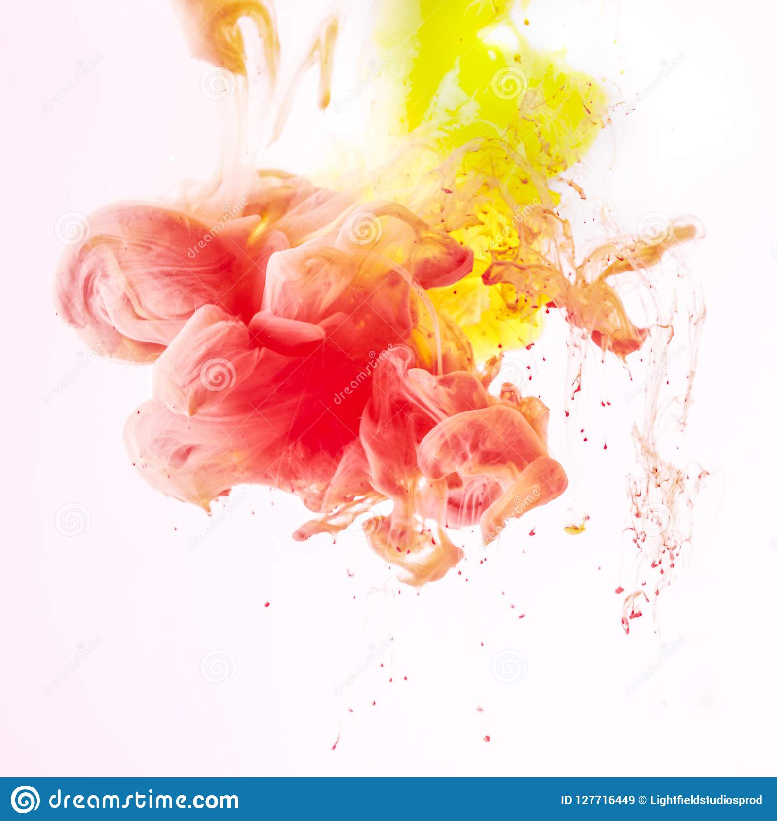 splashes of smoky yellow and red paint, isolated on white
