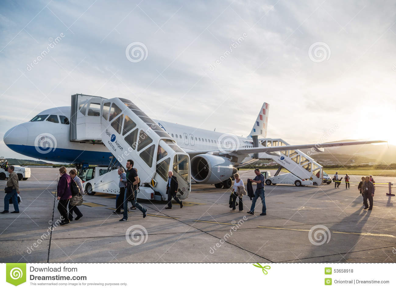 SPLIT, CROATIA - MARCH 6, 2015: Passengers exiting Croatia Airlines  Airbus A320 parked on a runway of Split Airport