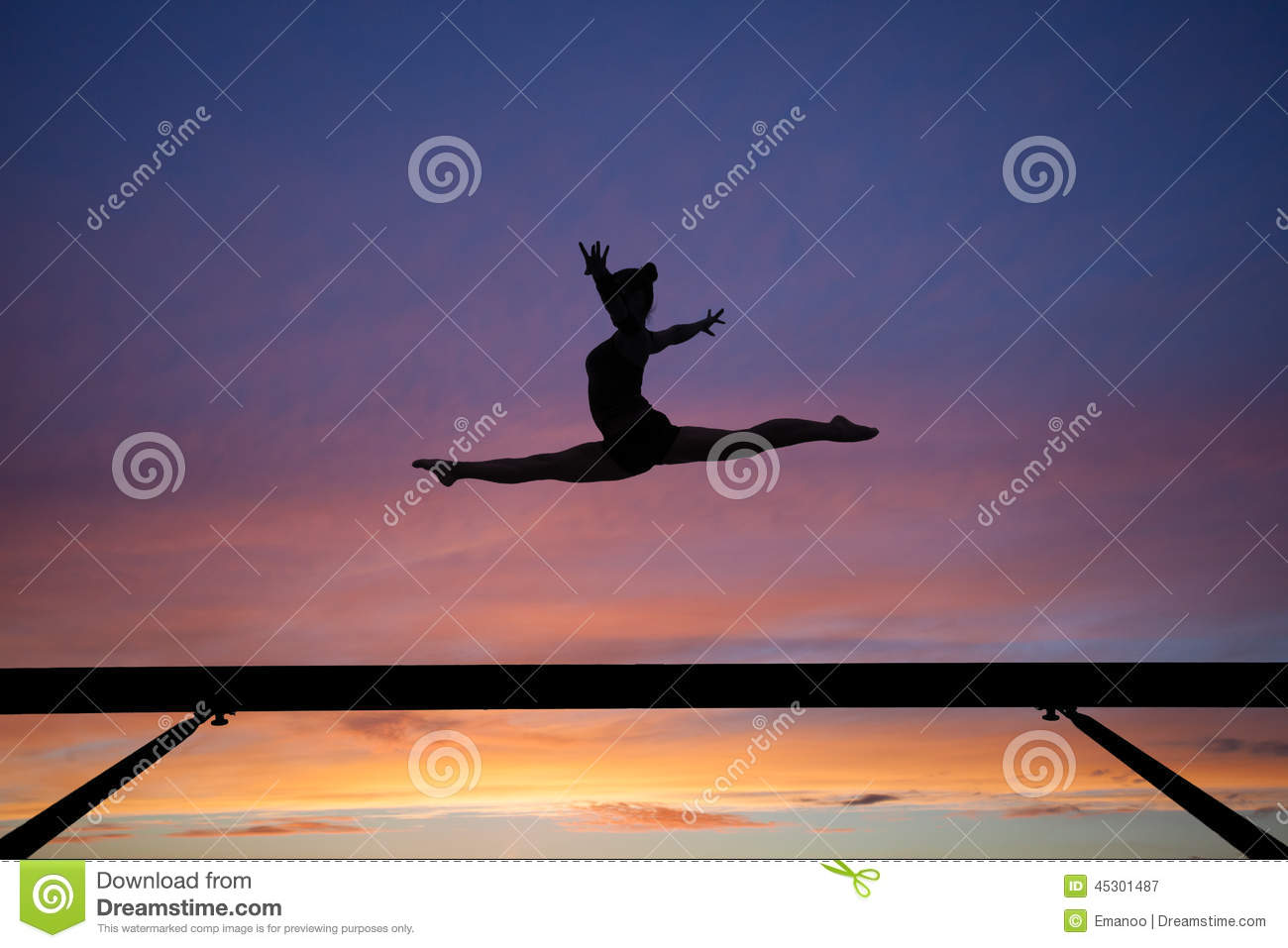 The Splits Jump On Balance Beam In Sunset Stock Image