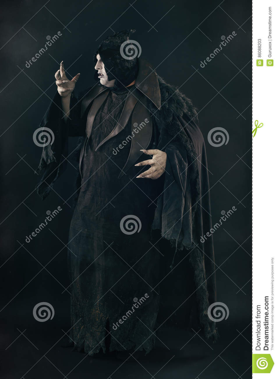 Spooky devil vamp with large scary nails. Hell and horror