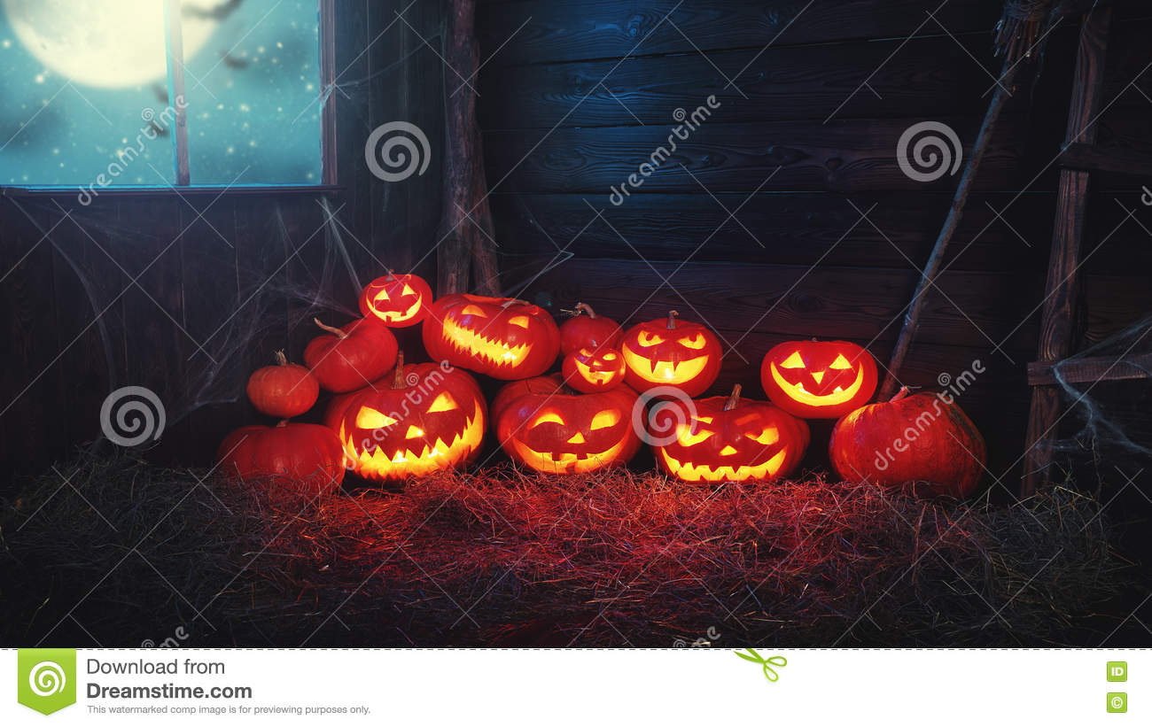 Spooky halloween background. scary pumpkin with burning eyes and