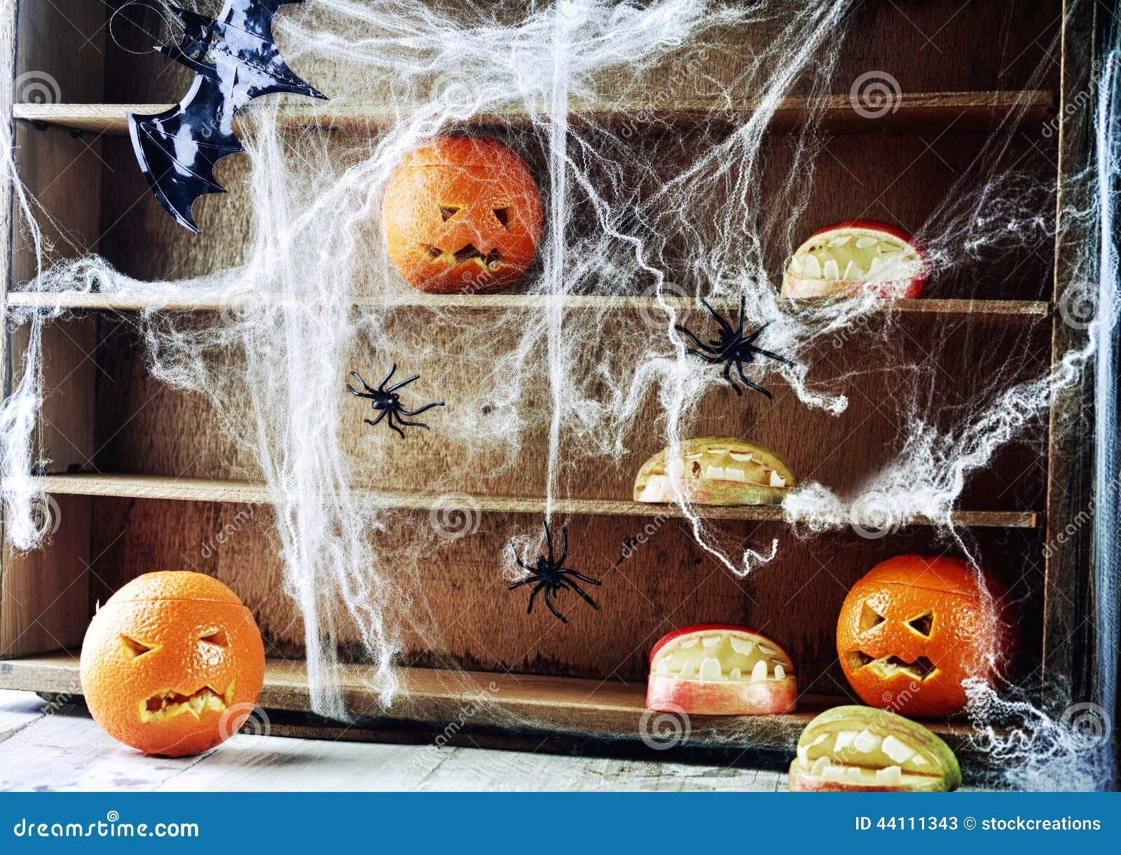 Spooky Halloween pantry with pumpkin lanterns