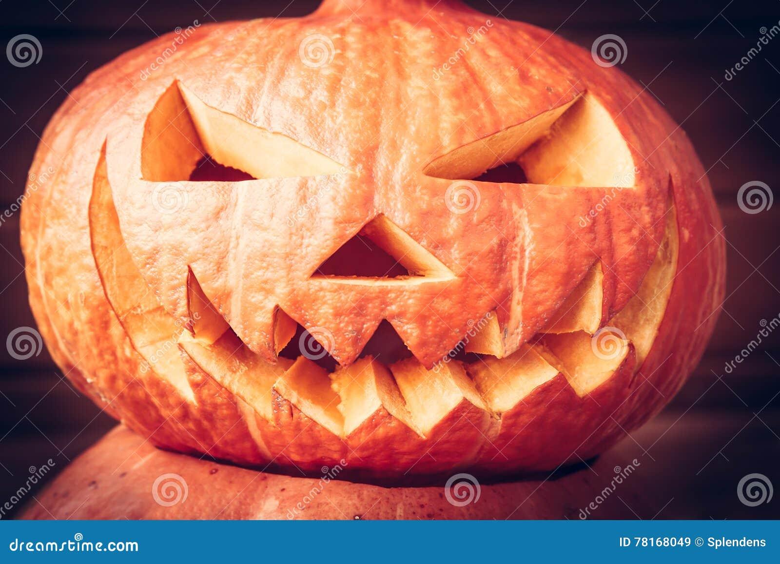 Spooky halloween pumpkin face on dark background