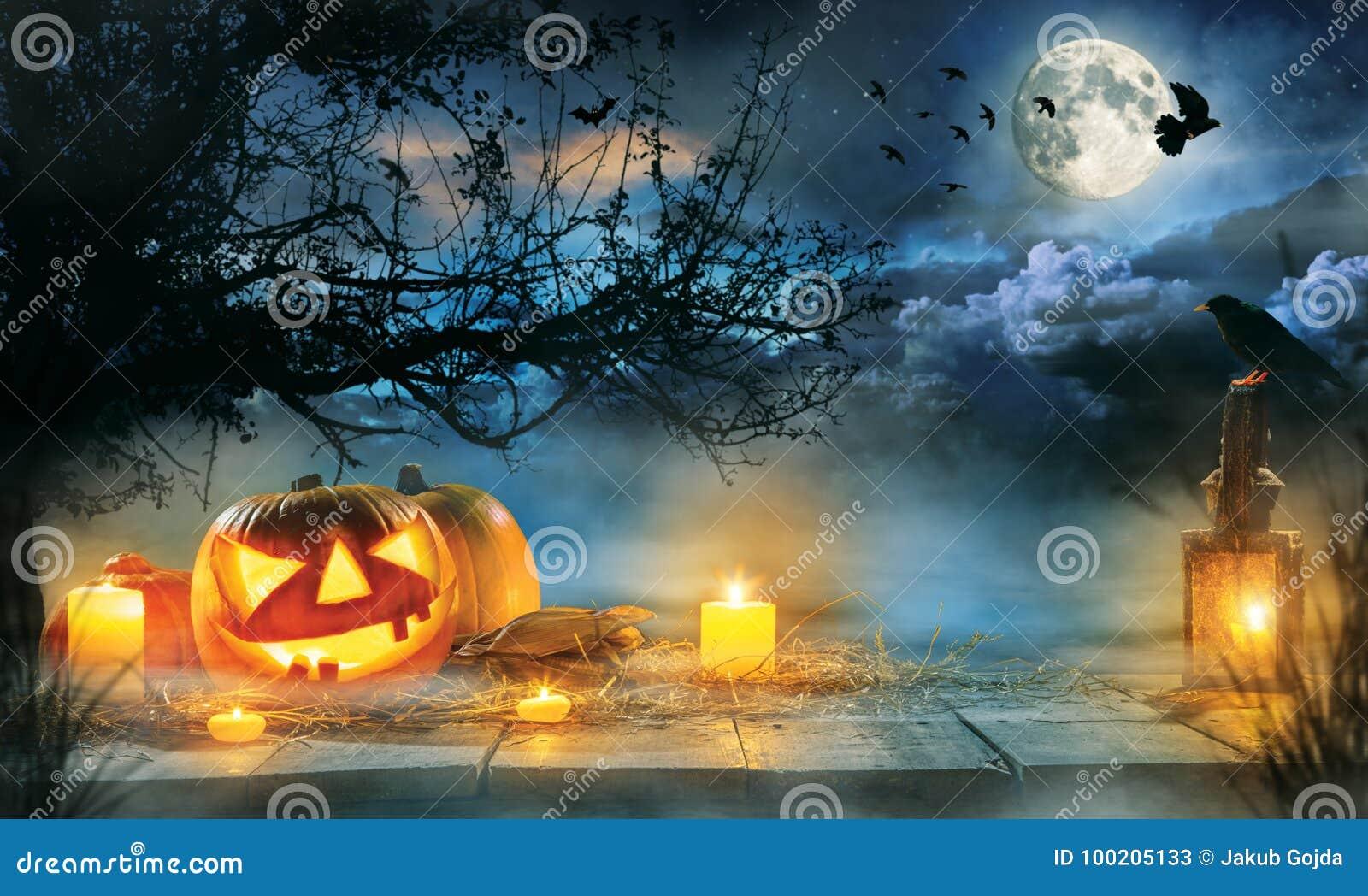 Spooky Halloween Pumpkins On Wooden Planks Stock Photo