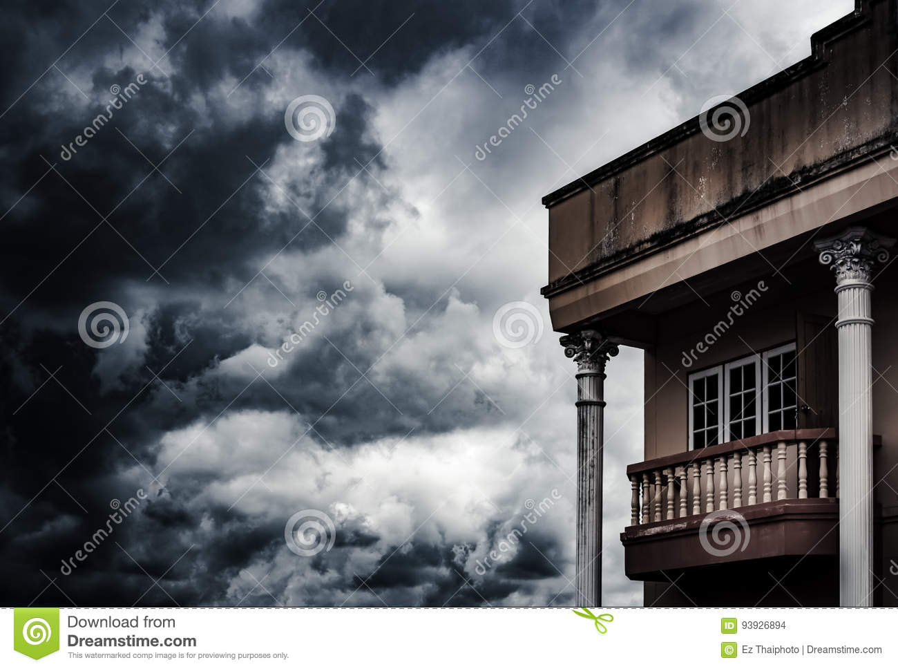 Spooky old house concept with cloud strom background and copy s